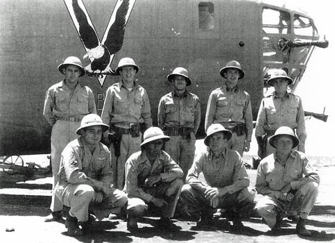 "The Dore Crew of ""Old Baldy"" in a photo taken some time before the Tidal Wave mission.  T/Sgt Lower is kneeling at the far left (B24bestweb.com)"